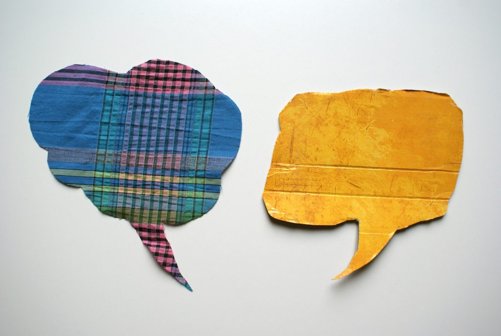 Two word balloons made out of cut fabric