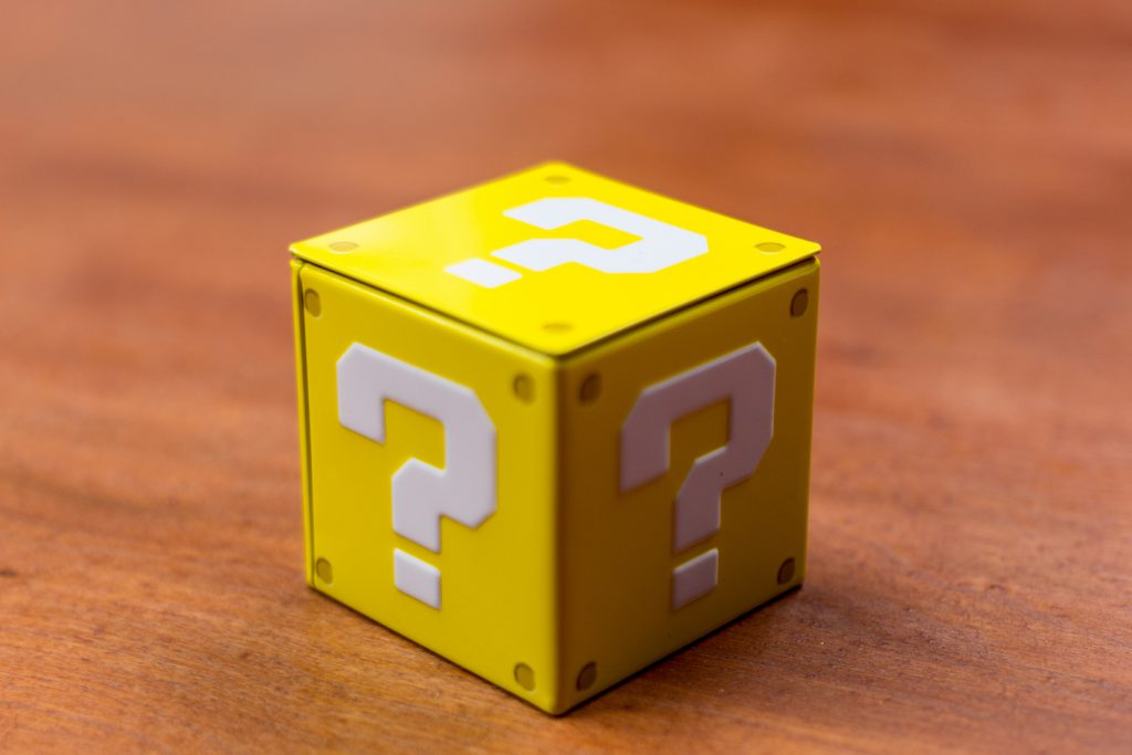 Yellow cube with question marks on each side