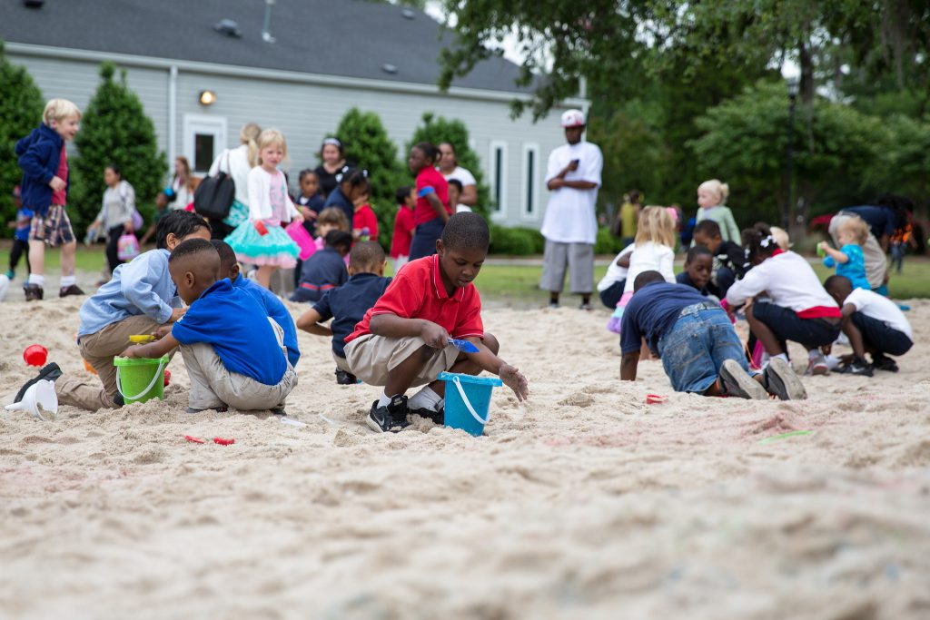 Children play in sandbox