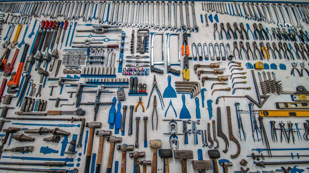 A wall covered in tools.